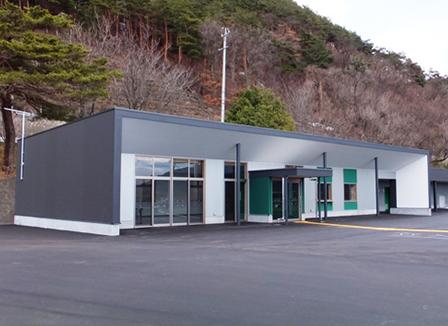 松本市かりがねサッカー場管理棟
